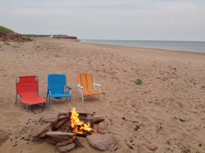 Beach and fire pit at Beach House at Cousin's Shore